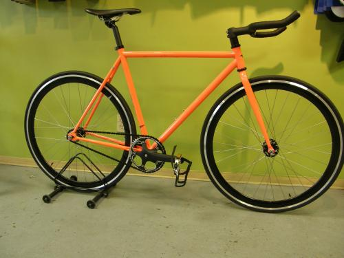Orange fixie bike by Single Bike Co